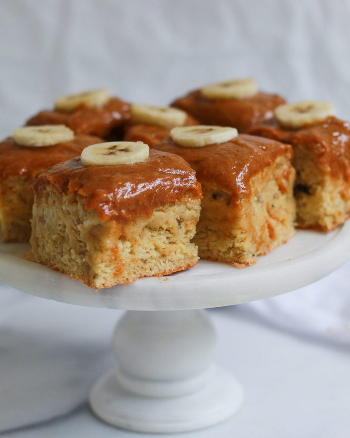 banana sheet cake squares on marble cake stand