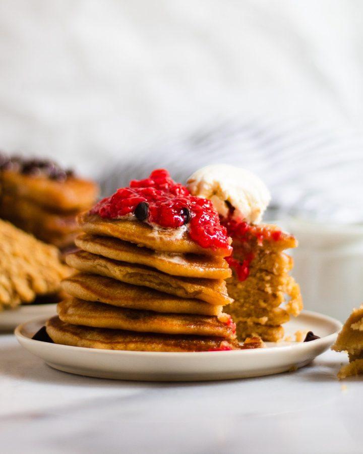homemade pancakes with raspberry jam and vegan cream cheese