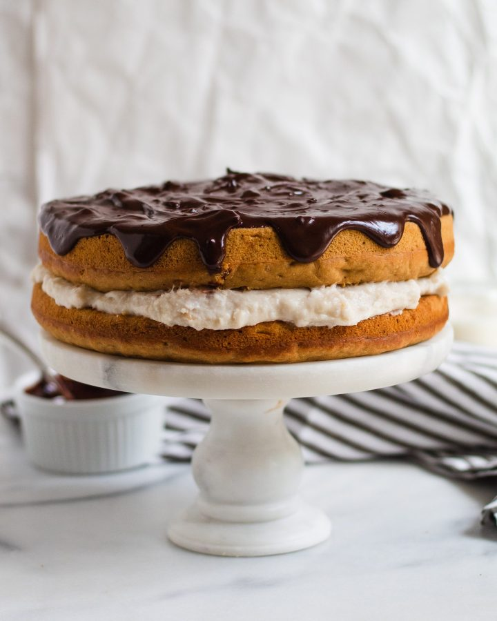 boston cream pie on cake stand