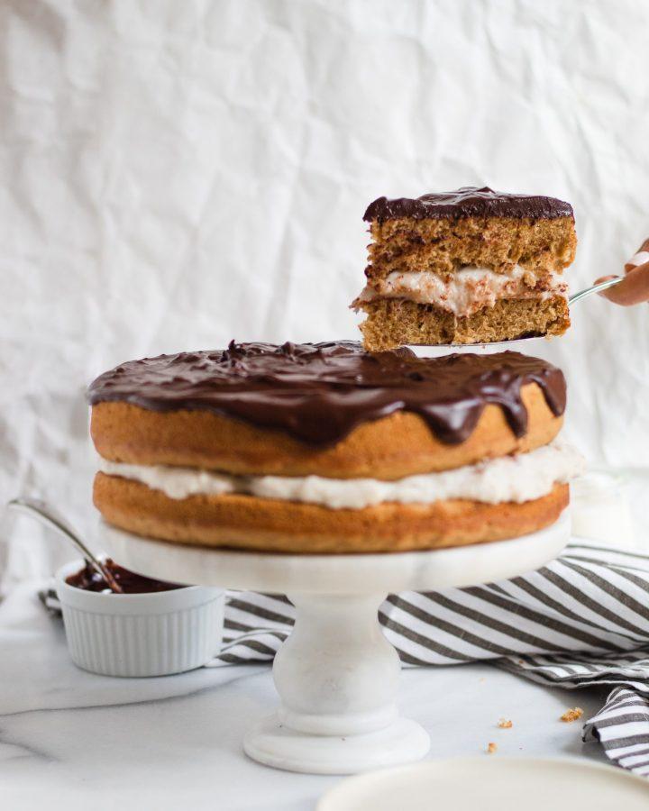 hand taking slice of cake