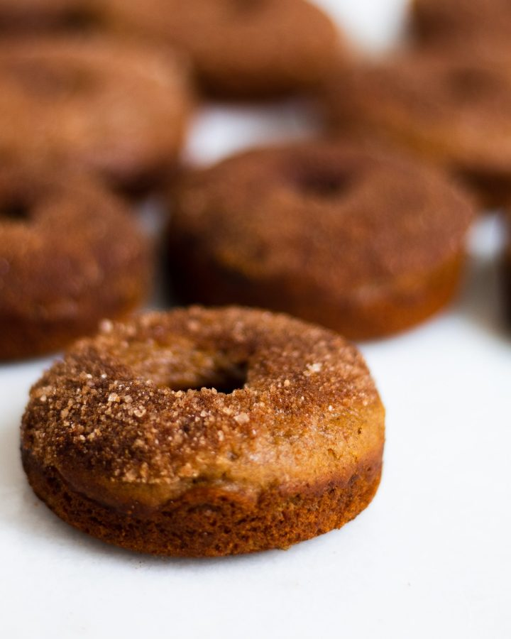 baked cinnamon sugar donuts on marble slab