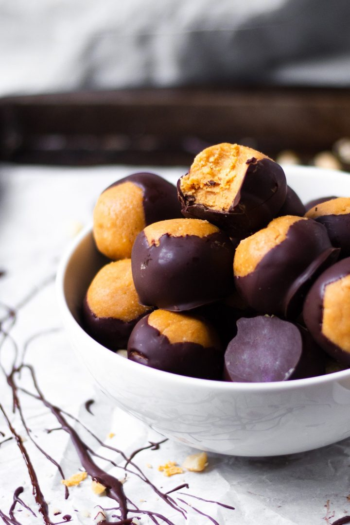 close up of bowl of peanut butter buckeyes