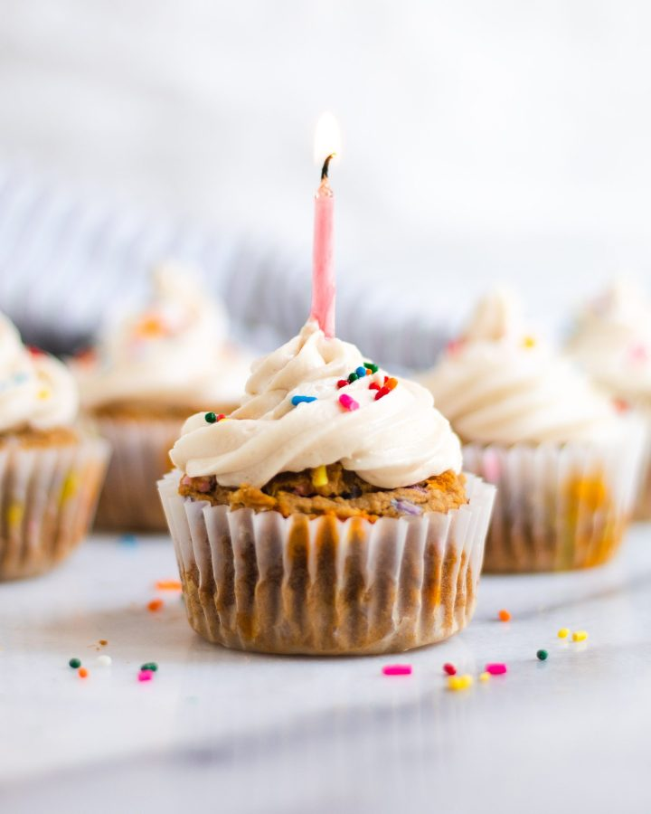 birthday candle in vanilla birthday cupcake