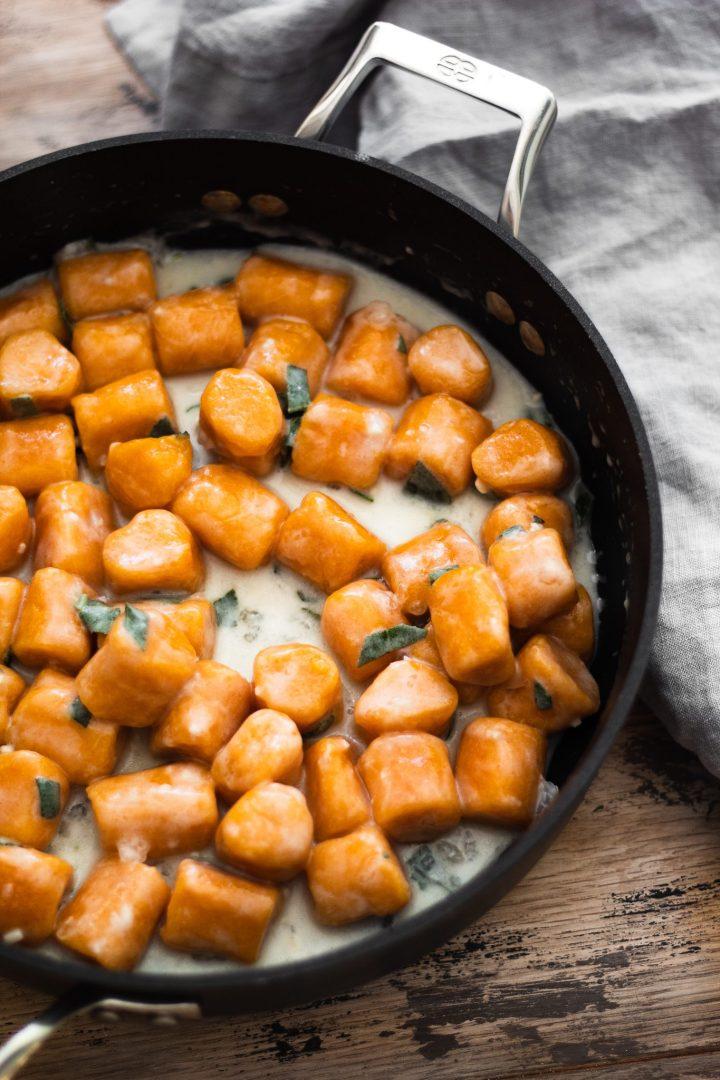 cooked gnocchi in garlic sage sauce