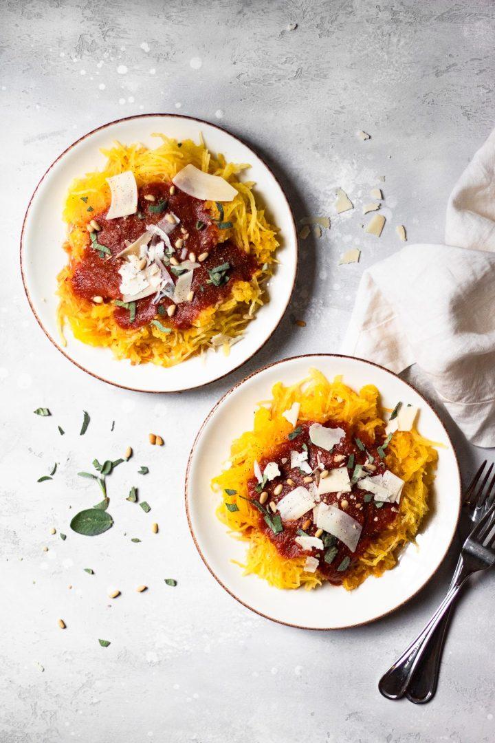 two plates of spaghetti squash with marinara