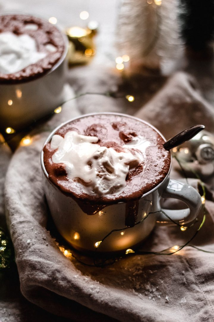 mug overflowing with hot chocolate