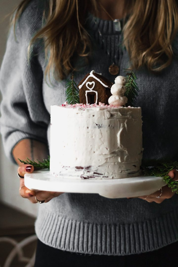 woman holding chocolate peppermint cake food photography