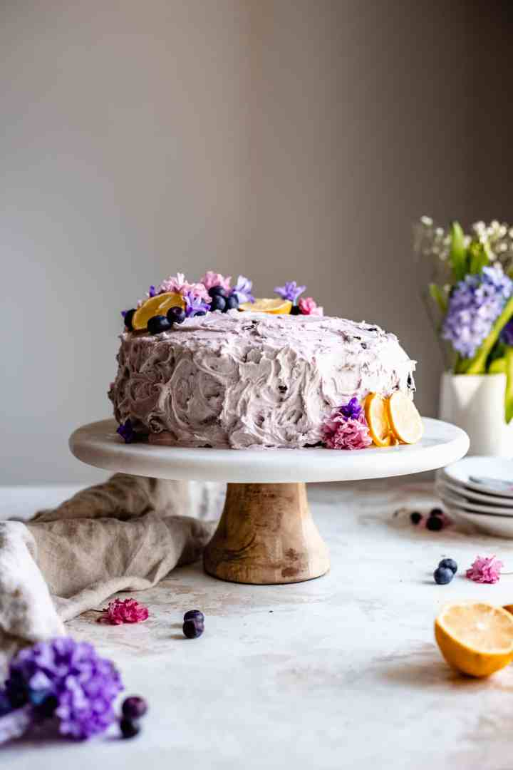lemon blueberry cake with lilacs and flowers
