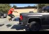 Jason Khalipa doing box jumps to back of truck bed