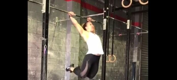 Kara Webb doing bar muscle-ups during a CrossFit workout. karawebb1/Instagram