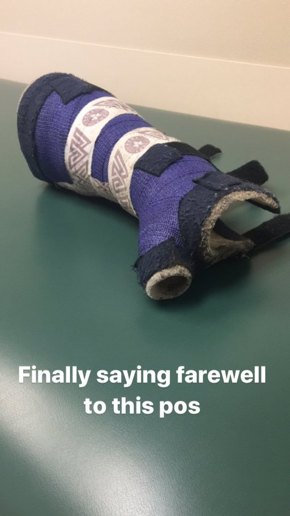 Austin Spencer's hard cast is removed a week after breaking it.