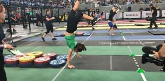 Tia-Clair Toomey on the handstand walk obstacle course during the 2017 CrossFit Invitational