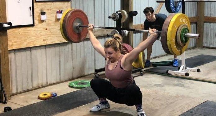 Kate Vibert hits a 107kg snatch in training. Screenshot via Instagram, @katevibert.