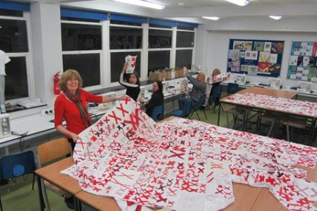 Nicole Davis, Head of Design & Technology, Fashion & Textiles at the Waldegrave School in the U.K., looks at the quilts and blocks made for The 70273 Project by students