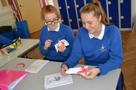 Students at the Waldegrave School in the United Kingdom make blocks for The 70273 Project