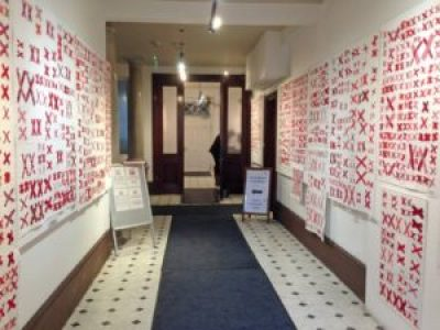 hallway lined with quilts