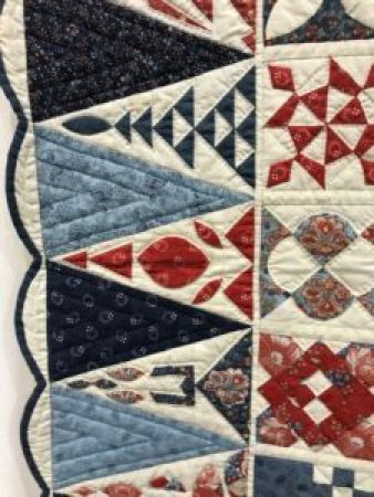 a closeup of the border of a quilt
