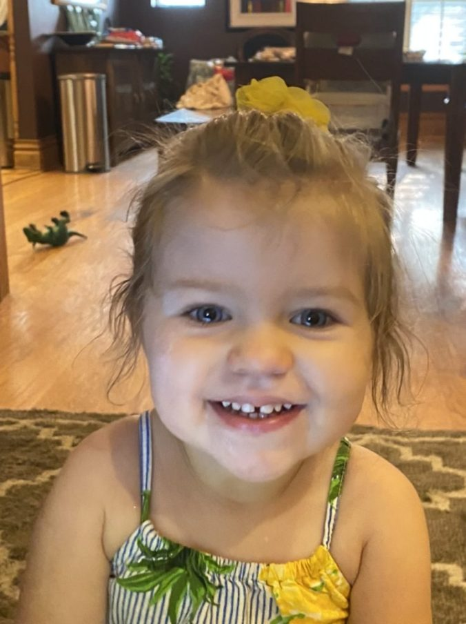 a young girl smiles