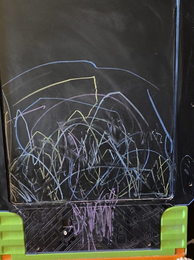 a child's drawings on a chalkboard