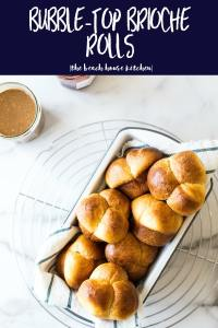 Overhead photo of bubble-top brioche rolls in loaf pan on a round wire rack