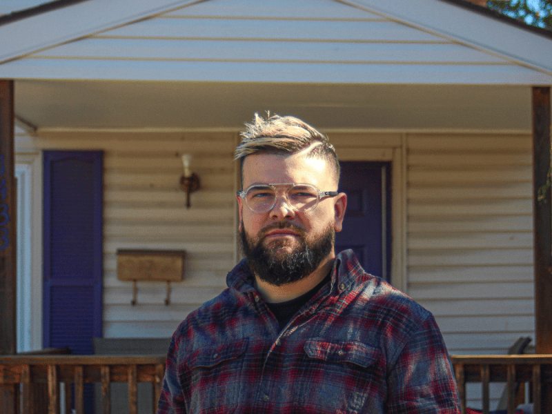 Rafael Medrano Jr. stands in front of his parents' home in the Argentine neighborhood in Kansas City, Kansas. Medrano Jr. is one of the thousands of Kansans who are registered as unaffiliated rather than with a political party. (Zachary Linhares/The Beacon)