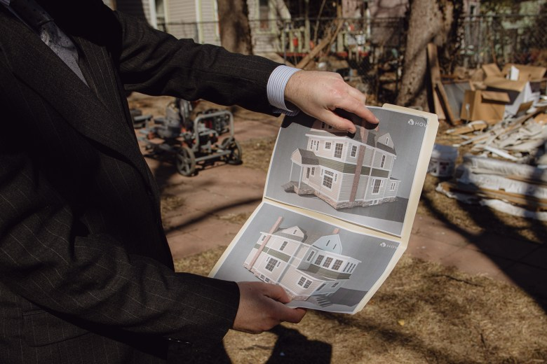 Jaggers shows renovation plans for his house in downtown. He used the $10,000 from Choose Topeka, a pay to move program in Kansas, to repair his roof.
