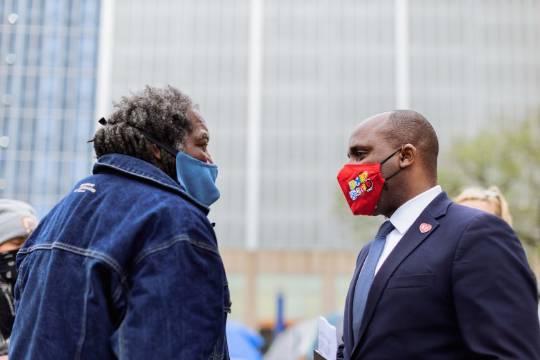 From left: Qadhafi, leader of the Kansas City Homeless Union, talks with Kansas City Mayor Quinton Lucas on April 7 in front of City Hall following another meeting to discuss the Homeless Union's demands.
