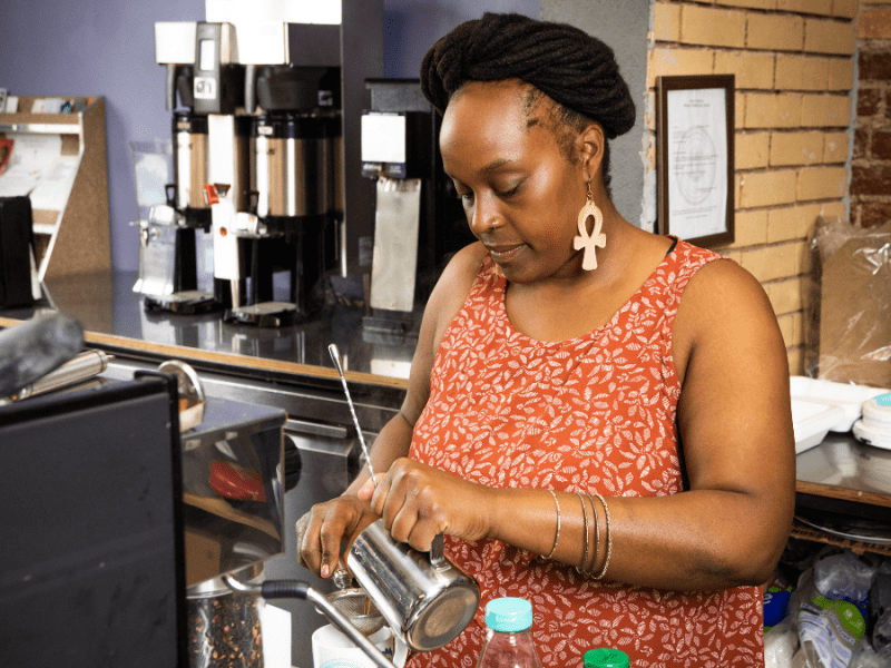 Nika Cotton makes a drink at Soulcentricitea, which she opened on Troost Ave. last July. Cotton applied for a grant from the Restaurant Revitalization Fund, but did not receive any money.