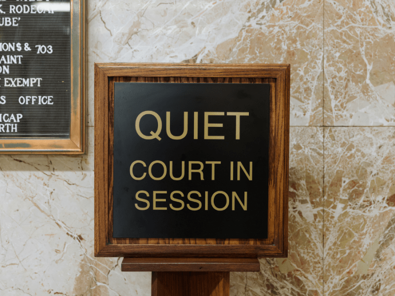 A sign is placed in front of a courtroom at the Jackson County Courthouse during eviction proceedings in September.