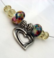 with handmade lampwork beads, chinese crystal and a silver toned charm
