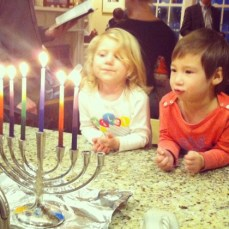 Hanukkah candles with her cousin.