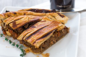 Steak and Ale Pie! Comfort food at it's best. Tender beef, carrots, mushrooms, and ale!