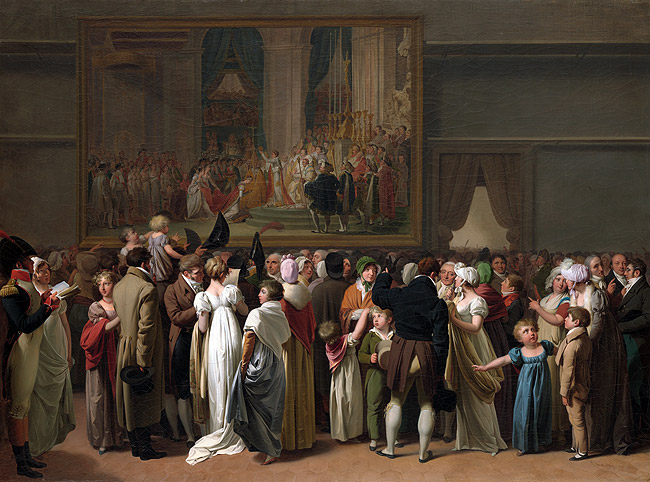 A group of people looking at a painting of a theatre scene