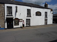 Facade of the Old Lion Pub with Ann standing in front