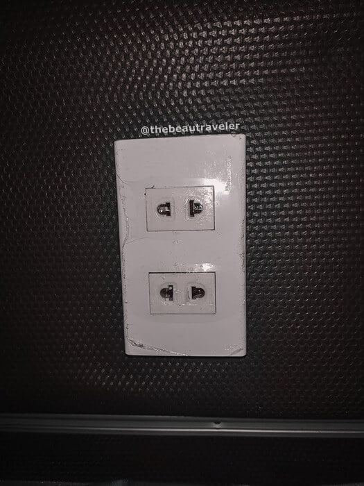 The electricity socket at the bus.