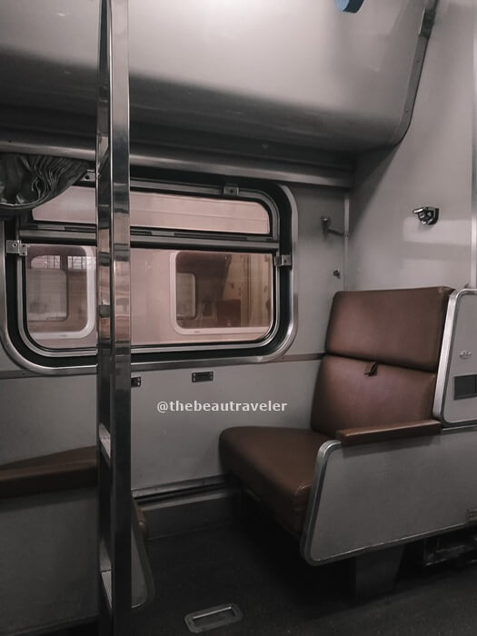 The seat at the second-class train before setting it into a bed.