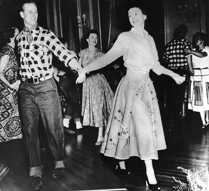 Queen Elizabeth II (then Princess Elizabeth) dances with her husband, the Duke of Edinburgh, at a square dance held in their honour in Ottawa, by Governor General Viscount Alexander, 17th October 1951. The dance was one of the events arranged during their Canadian tour. (Photo by Keystone/Hulton Archive/Getty Images)