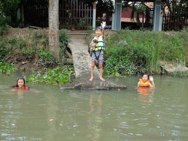 Kids washing in the canal, Cai Be