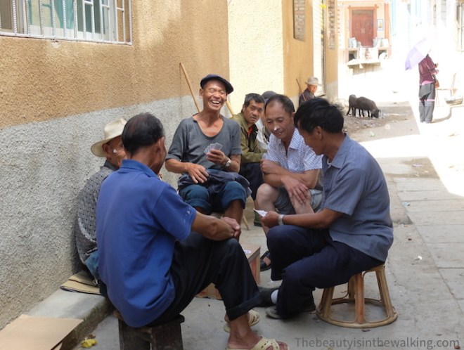 Men are playing cards