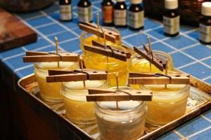 Mason jars filled with beeswax and coconut oil candles