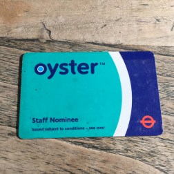 Oyster card, staff nominee version, using turquoise as the main colour. Early versions of the Oyster card used the red roundel, replaced with white later on to avoid anyone thinking it was only valid on London Buses. Photo by Daniel Wright [CC BY-NC-ND 2.0] via this flickr album