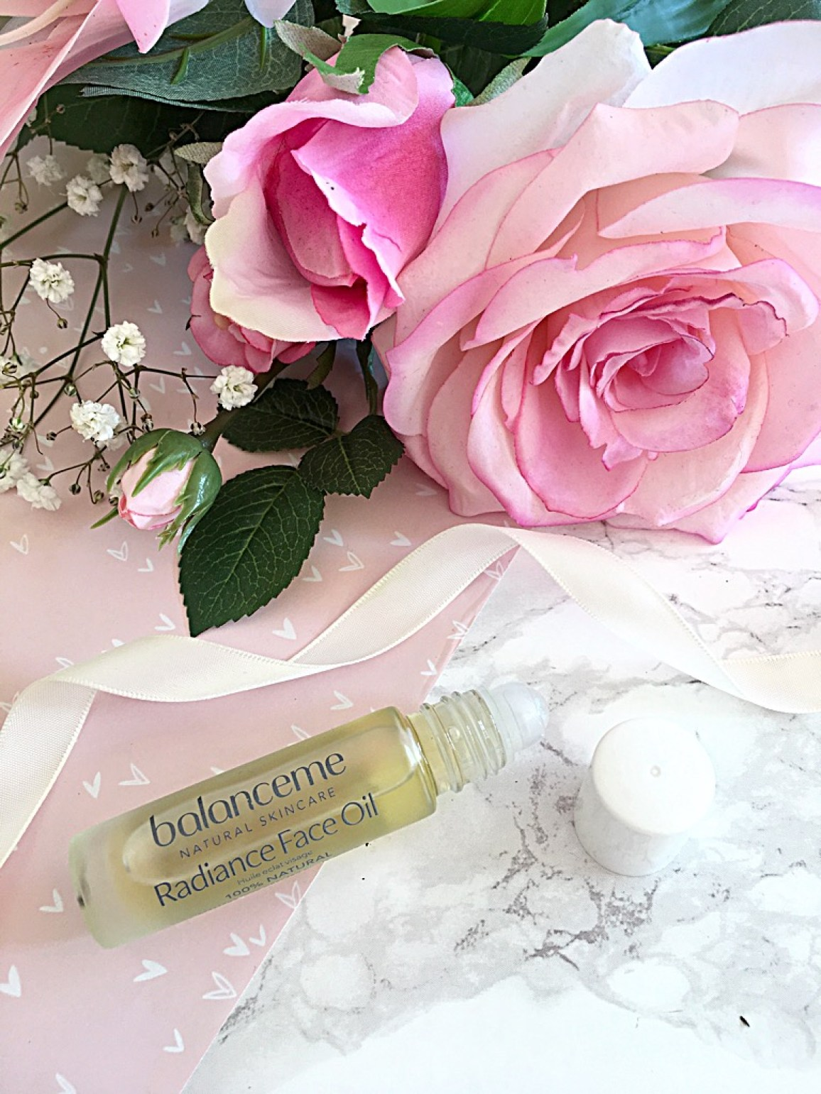 image shows a bottle of Balanceme Face Oil with roller ball application.