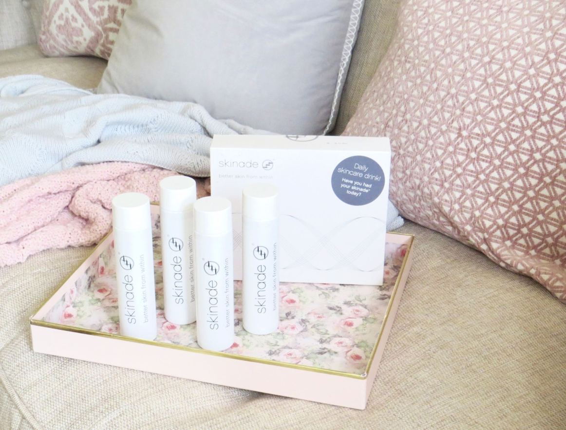 image shows a floral tray with 4 bottles of skinned plus the box.