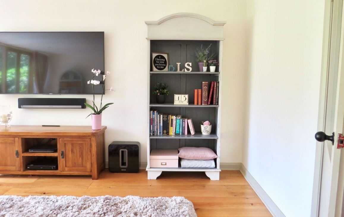 Shabby chic. Image shows the finished bookcase dressed with books and ornaments etc.