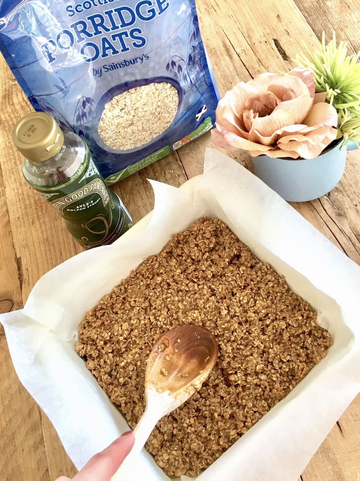 Image shows the ingredients with the flapjacks in the tin.