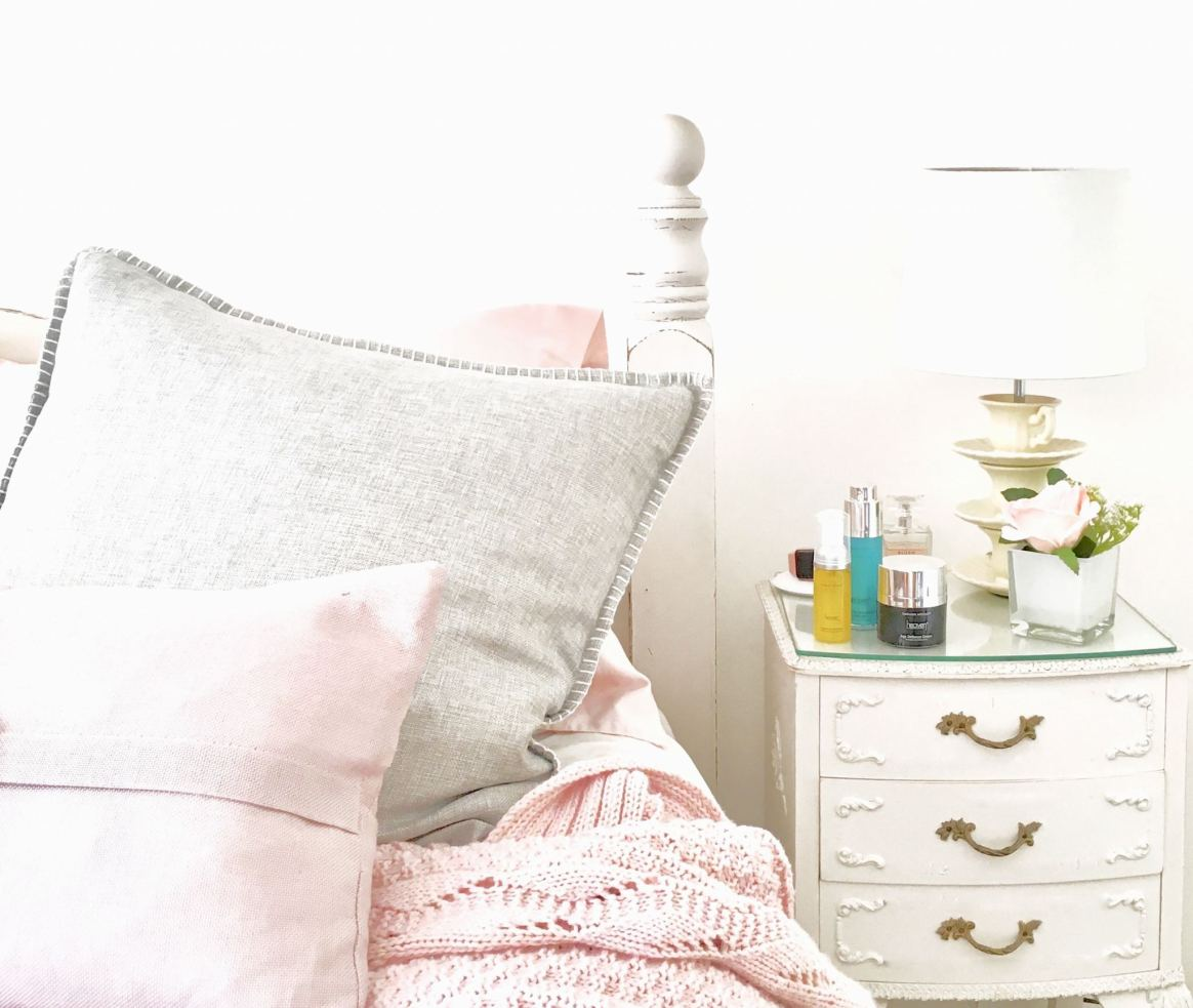 image shows my bedside table/night stand with my Heaven Skincare products sitting on it