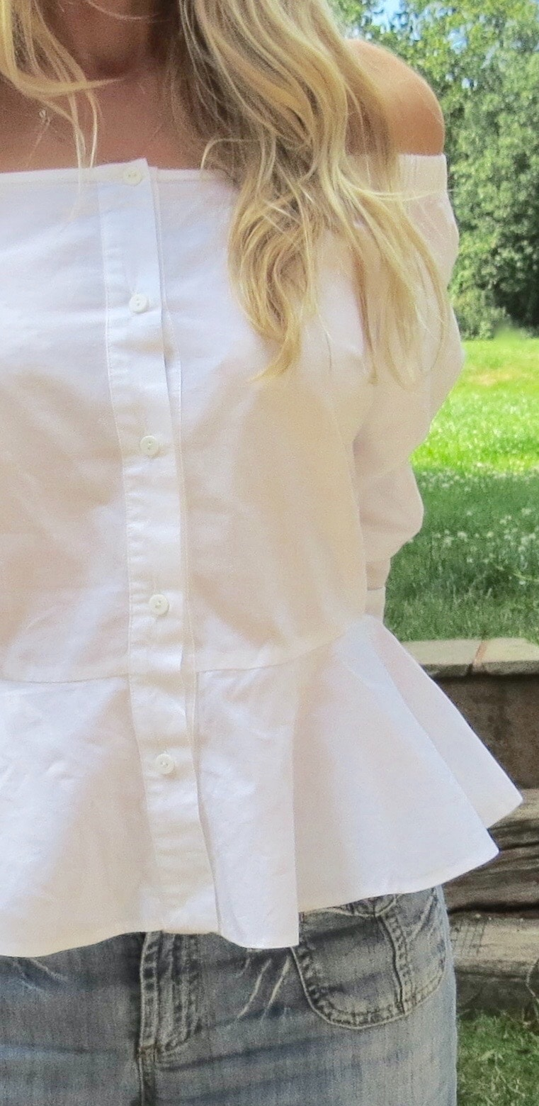 image shows front view of Asos frill hem off shoulder shirt. The white edit.