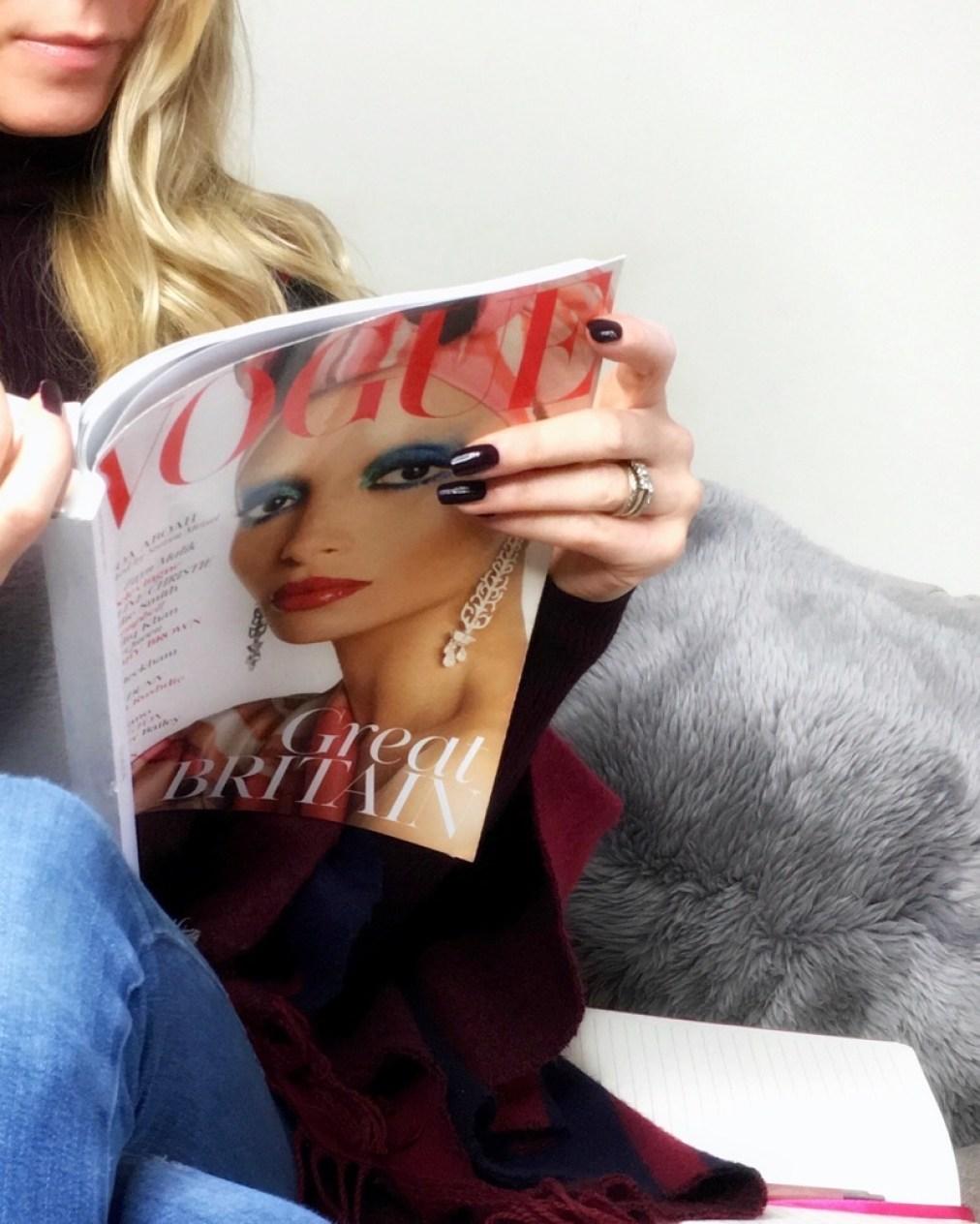 Samantha reading Vogue magazine