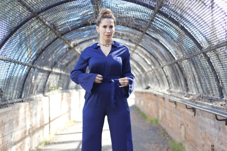 woman wearing a jumpsuit in the color of the year 2020
