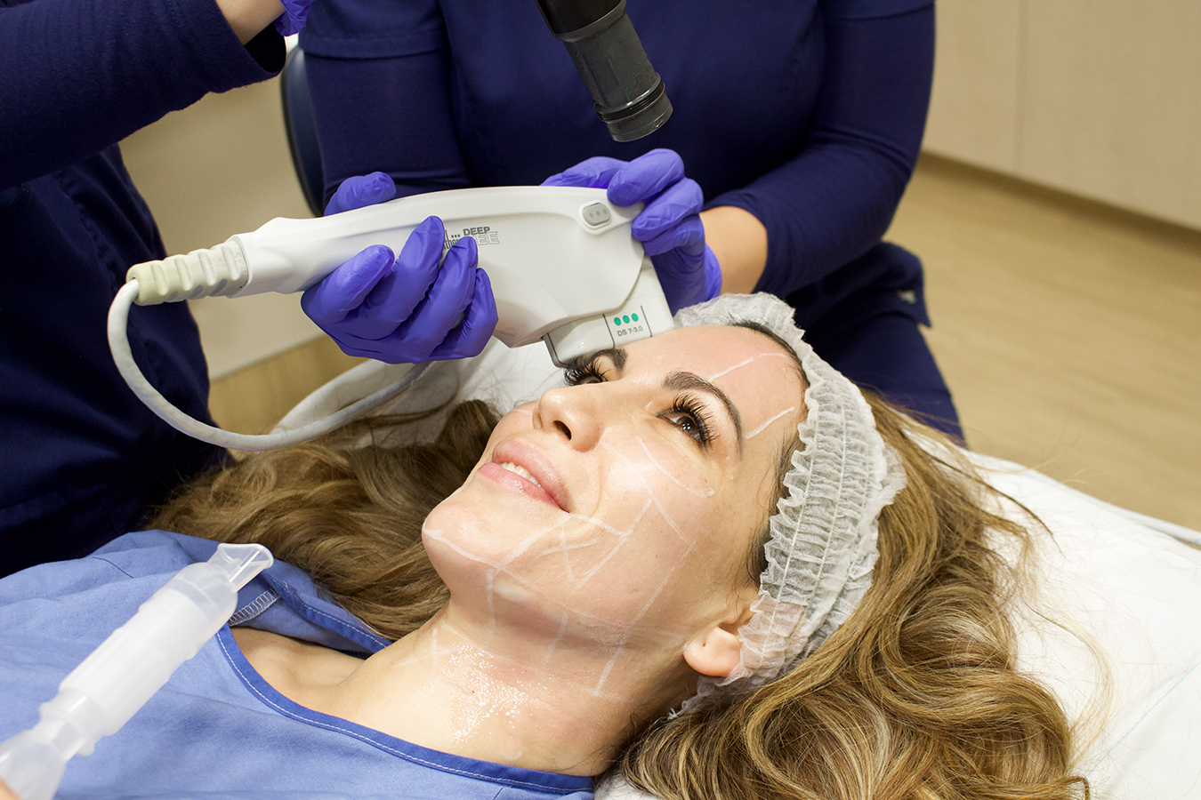 woman getting a skin tightening treatment called Ultherapy
